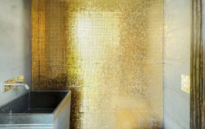Golden-wall-and-black-bleustone-sink-in-this-contemporary-bathroom-via-Bloggingpet